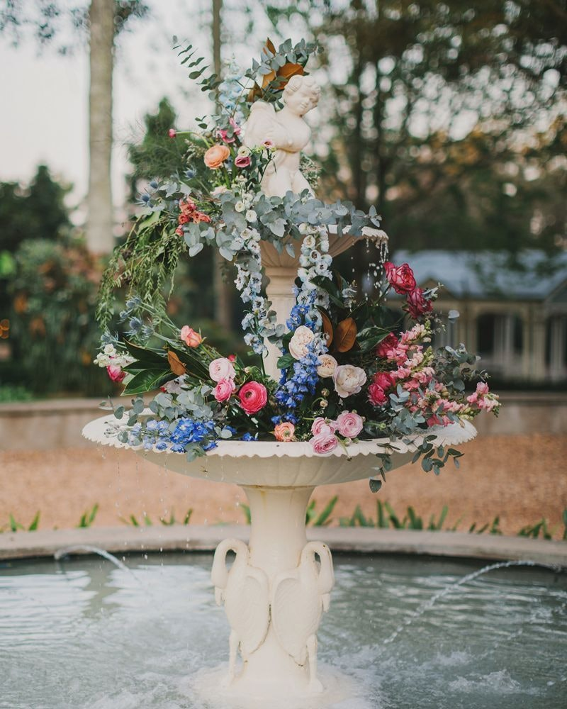 Fountain at Gabbinbar Homestead decorated in pink and blue flowers