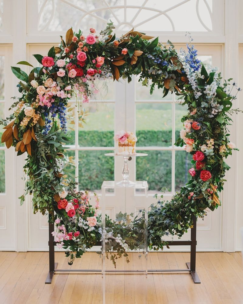 Wedding round arbor with pretty pink and blue flowers