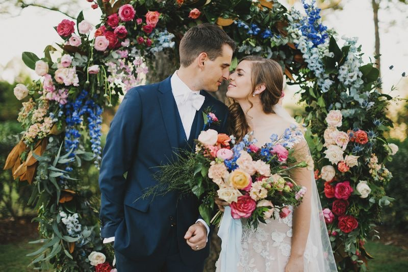Couple kiss under round arbor