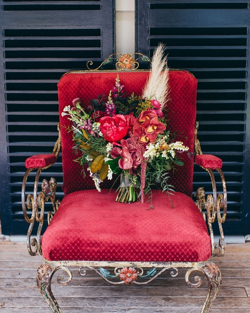 Flower bouquet on red velvet chair