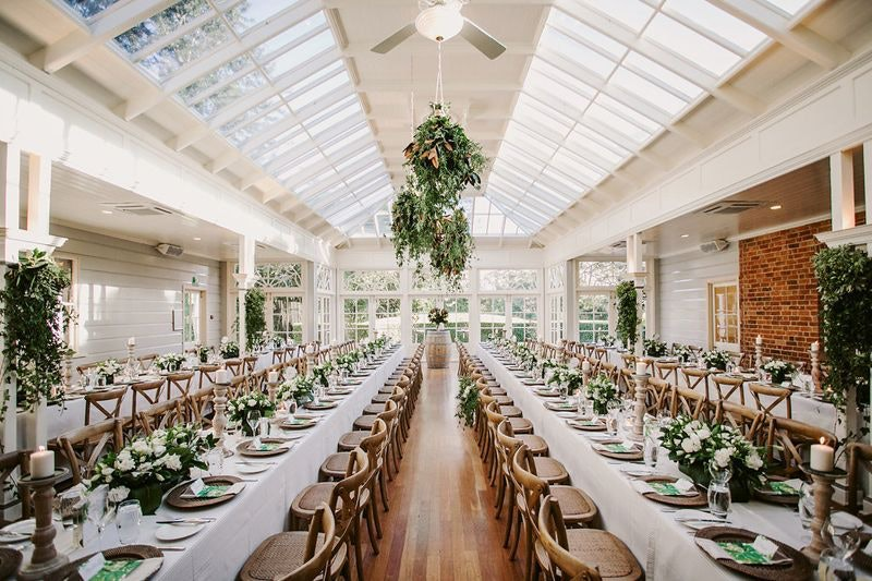 Reception venue with white and green theme