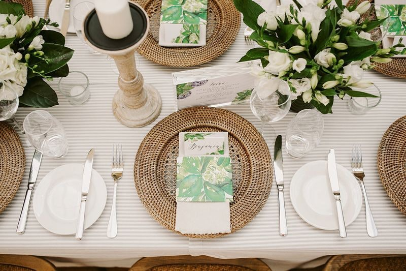 Rattan charger plates with striped tablecloth