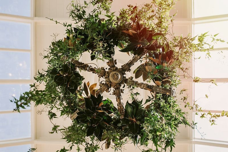 The Conservatory chandelier decorated with greenery