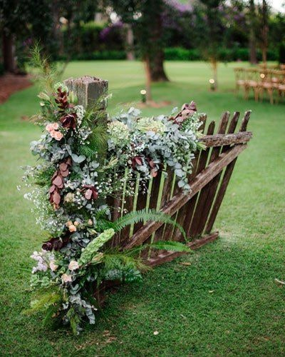 Wedding floral installation decorating an old gate