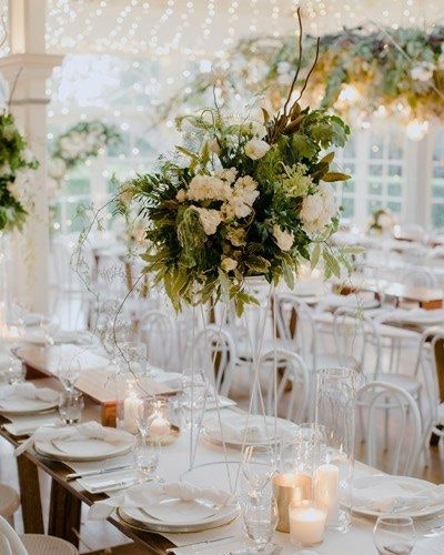 Green table arrangement with white roses