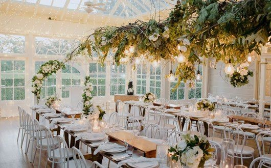 Green wedding installation hanging from ceiling