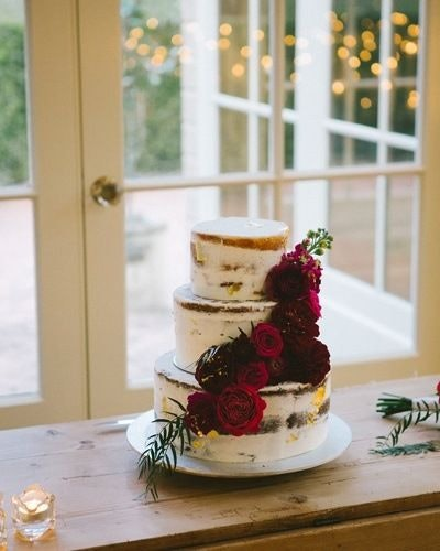 Three layer naked cake with red roses