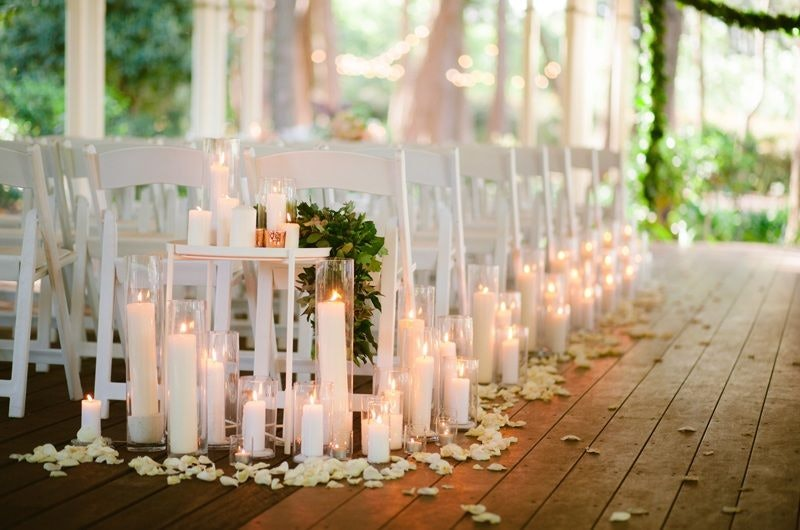 Candles line wedding aisle