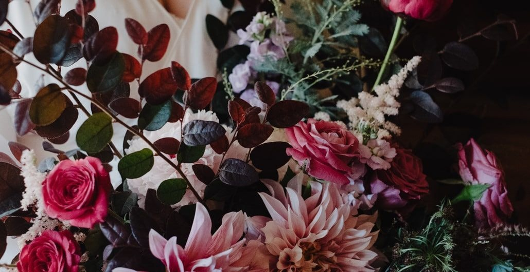 Wedding bouquet using dark pink, light pink and deep greens