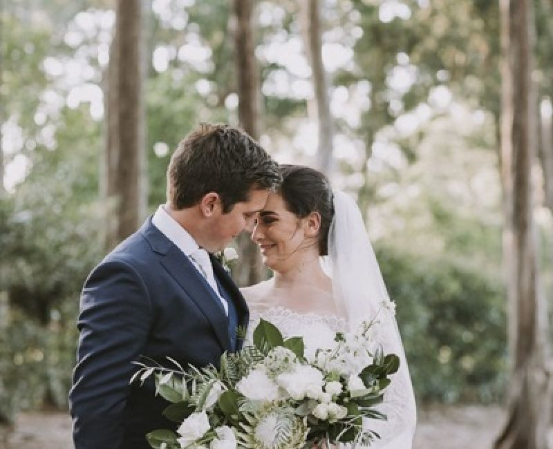 Sweet Couple With White Flowers Bouquet