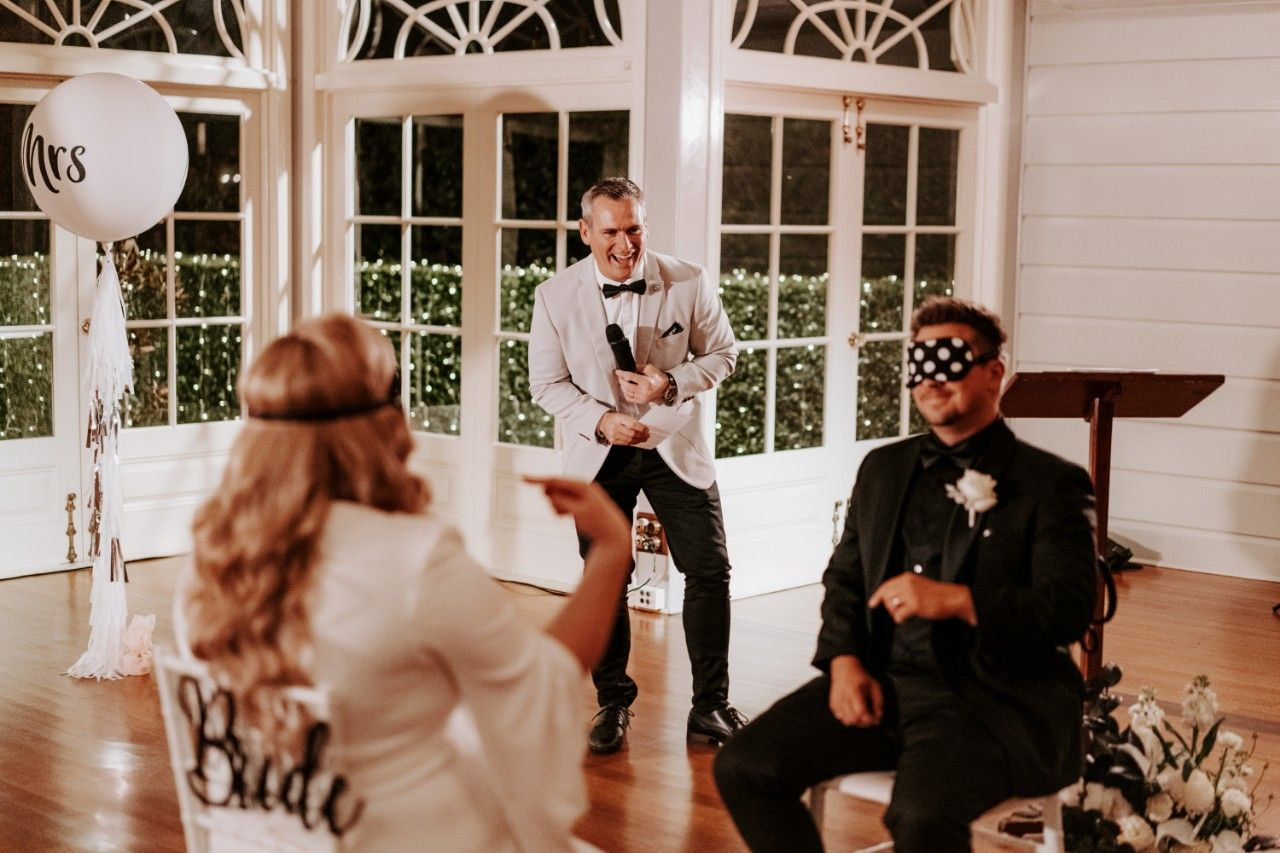 Couple play game at wedding with blindfolds