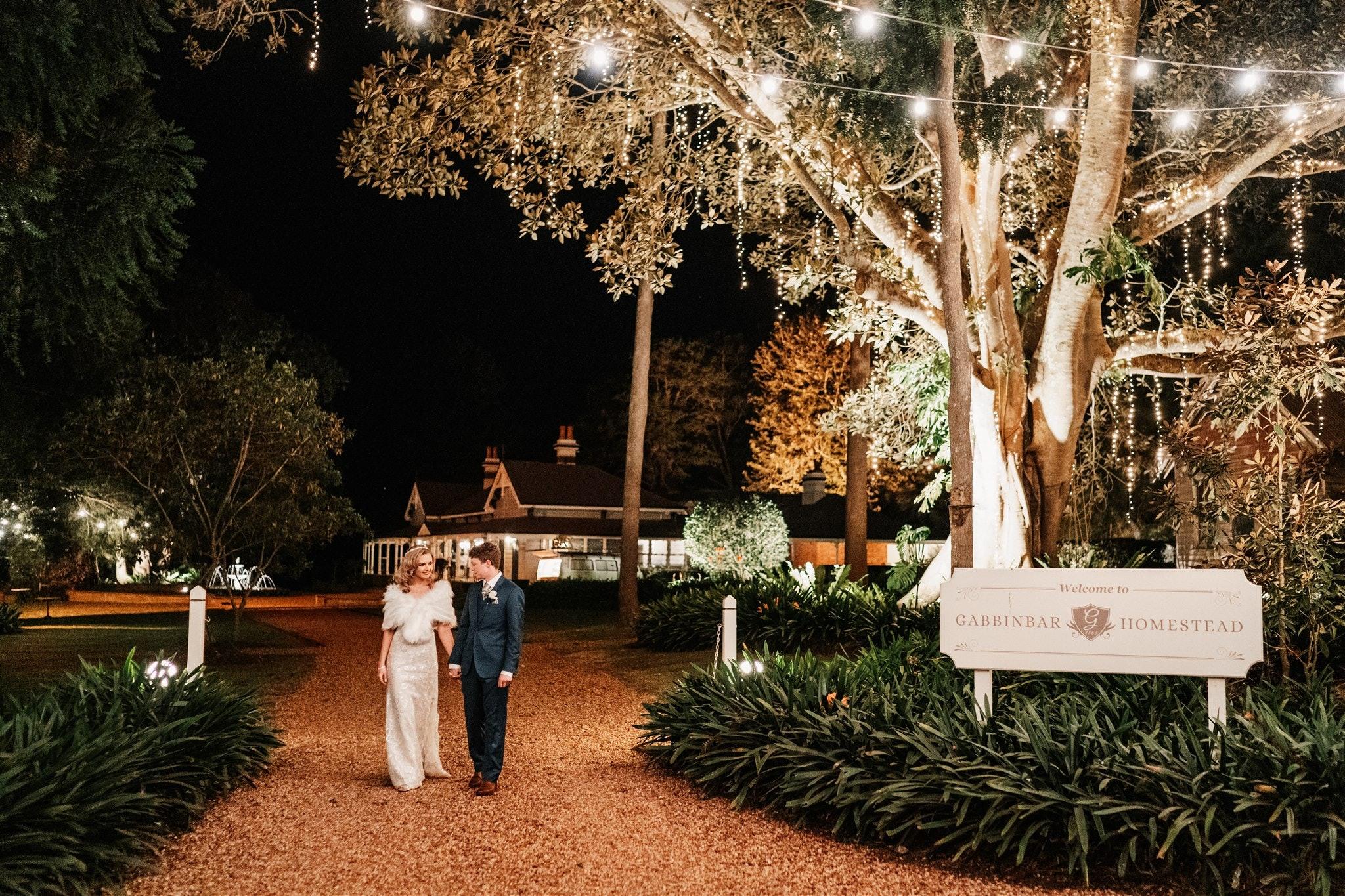 Couple stroll in Toowoomba night garden