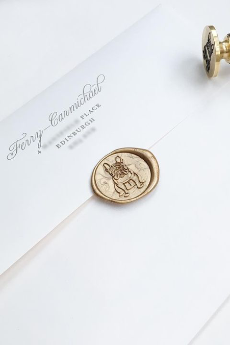 Gold wax seal with dog image