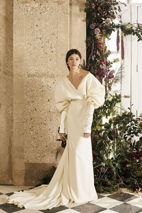 Dramatic bridal gown with large, voluminous sleeves