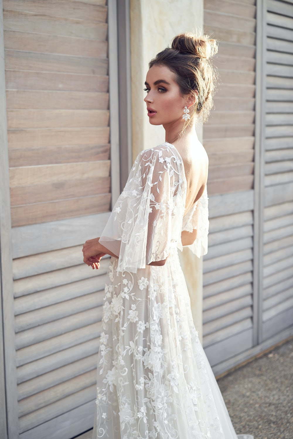 Beaded wedding gown with draped sleeve