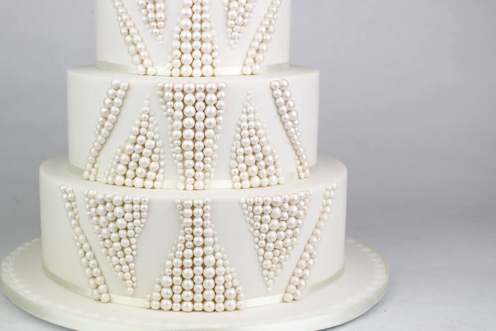 White wedding cake with pearl icing beads
