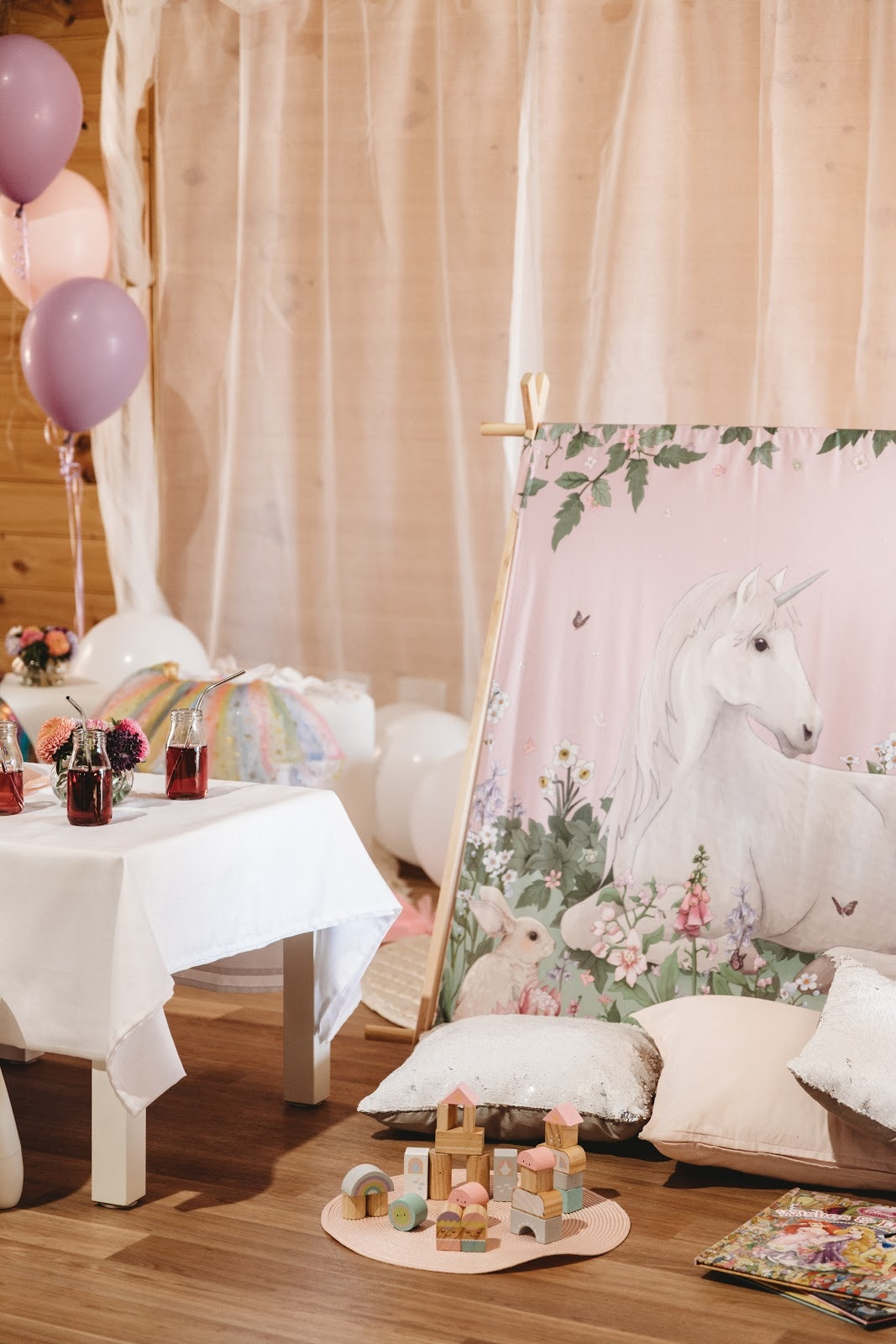 Playroom set up for children with unicorn teepee and toys and drinks