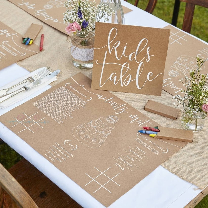 kids table set with custom placemats and crayons for colouring