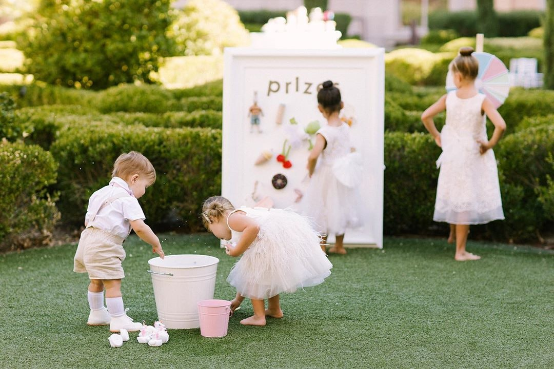 children at a wedding playing with outdoor games