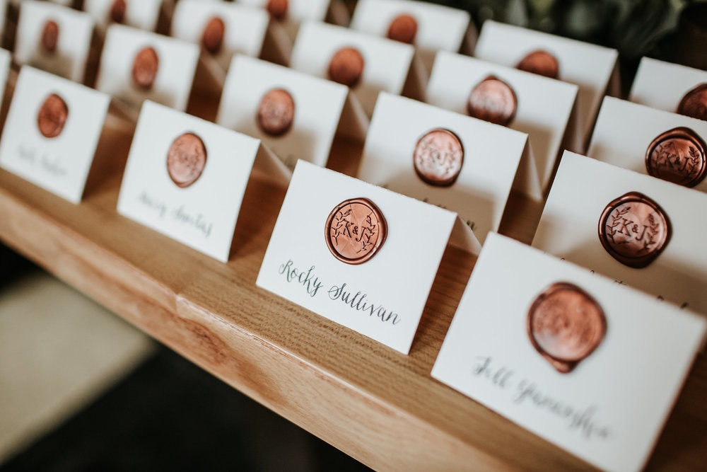 Place cards with a bronze monogram seal