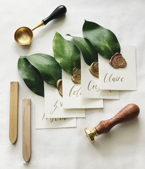 monogram place cards with green leaves and stamping kit