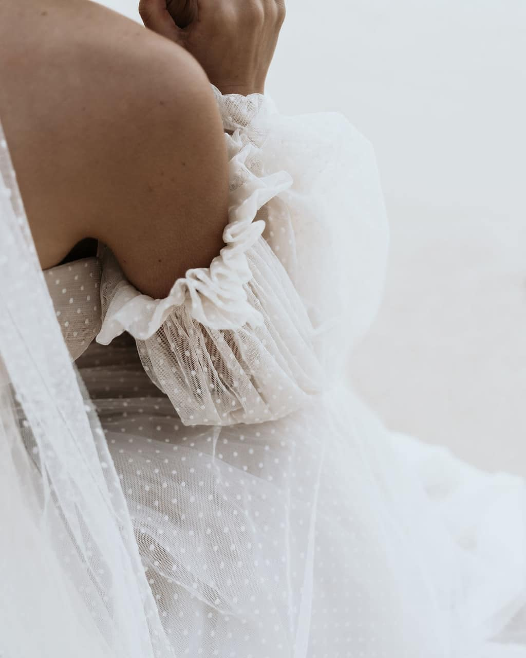 Bride with dress that has detachable lace sleeves