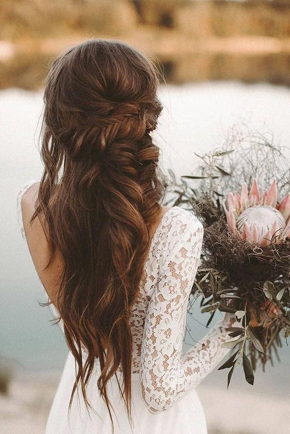 Bride with long braided hair half up half down