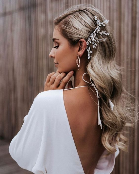Bride with long flowing hair held in place by a embellished clip