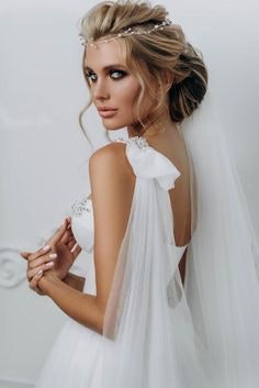 Bride with hair in a relaxed chignon wth a decorative headpiece