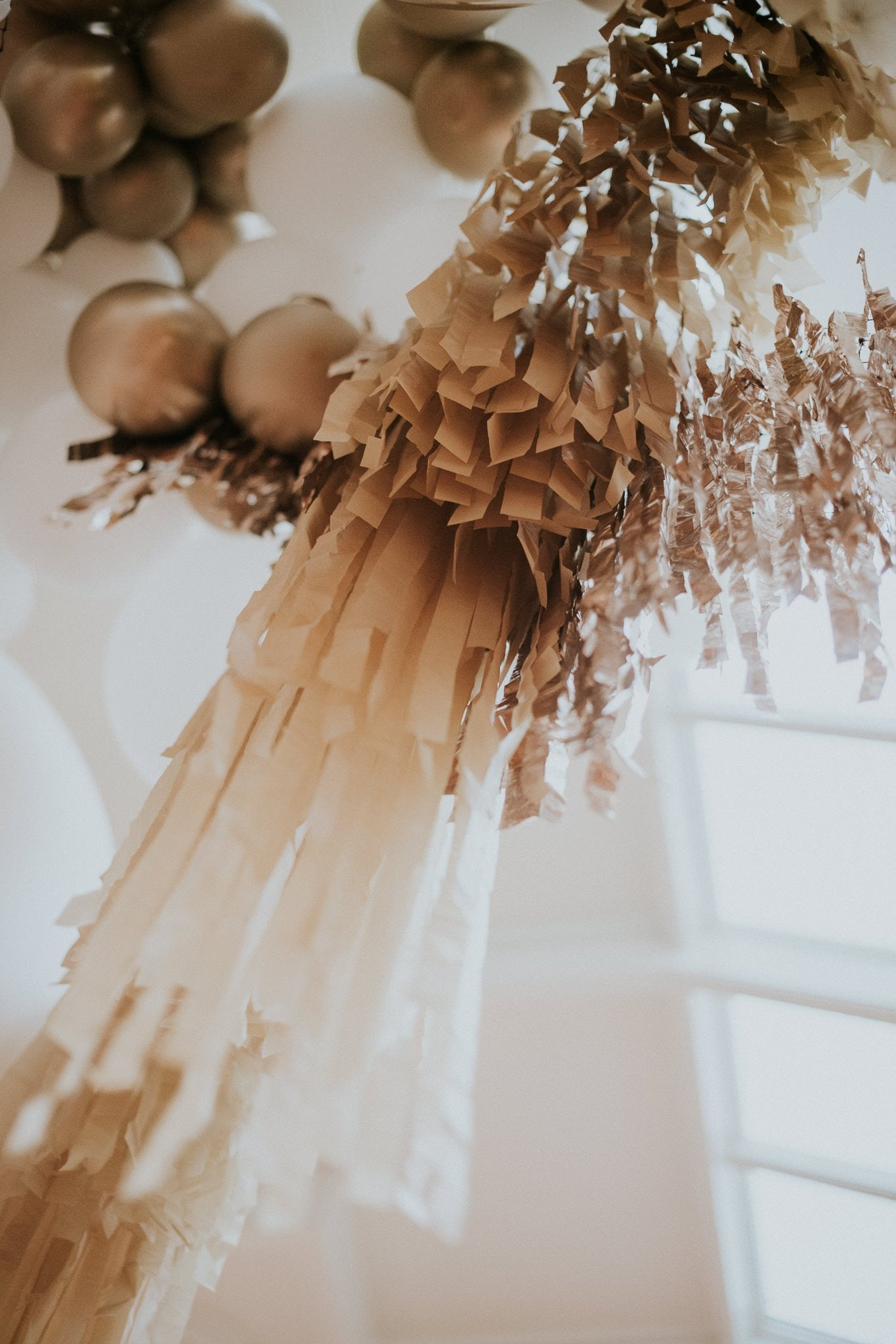 Gold and white streamer garland hanging from the roof