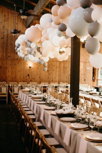 Long reception tables with balloons hanging overhead