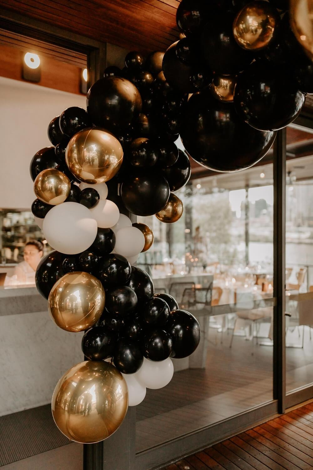 Black, gold and white balloon garland