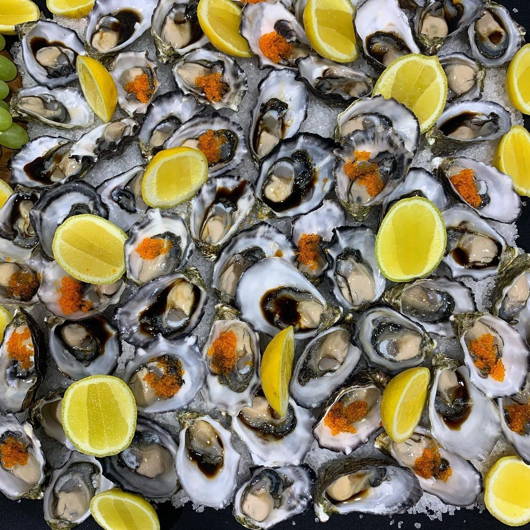 Oysters with lemon wedges