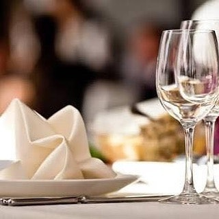Two glasses of wine and napkin folded on table