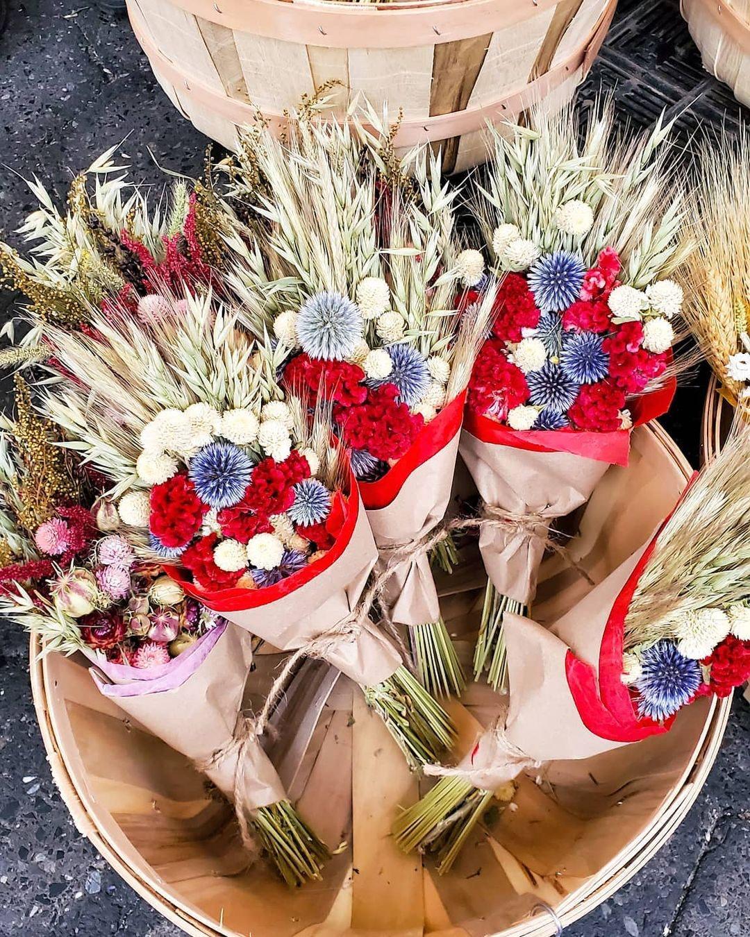 Dried flower arrangements in a wooden bucket