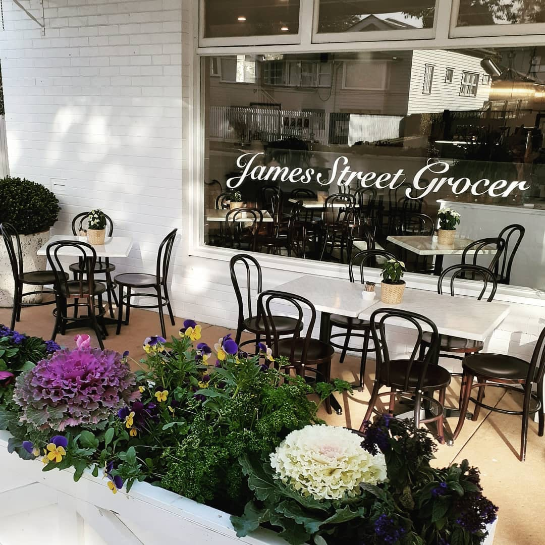 James Street Grocer shopfront with white bricks and black chairs