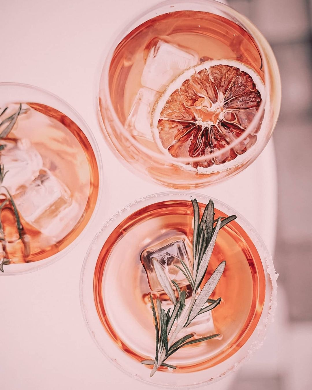 Cocktails with rosemary and candied orange