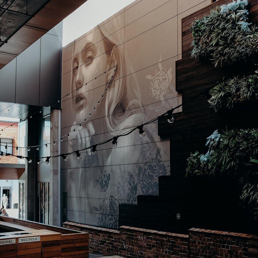 Mural on wall of girl