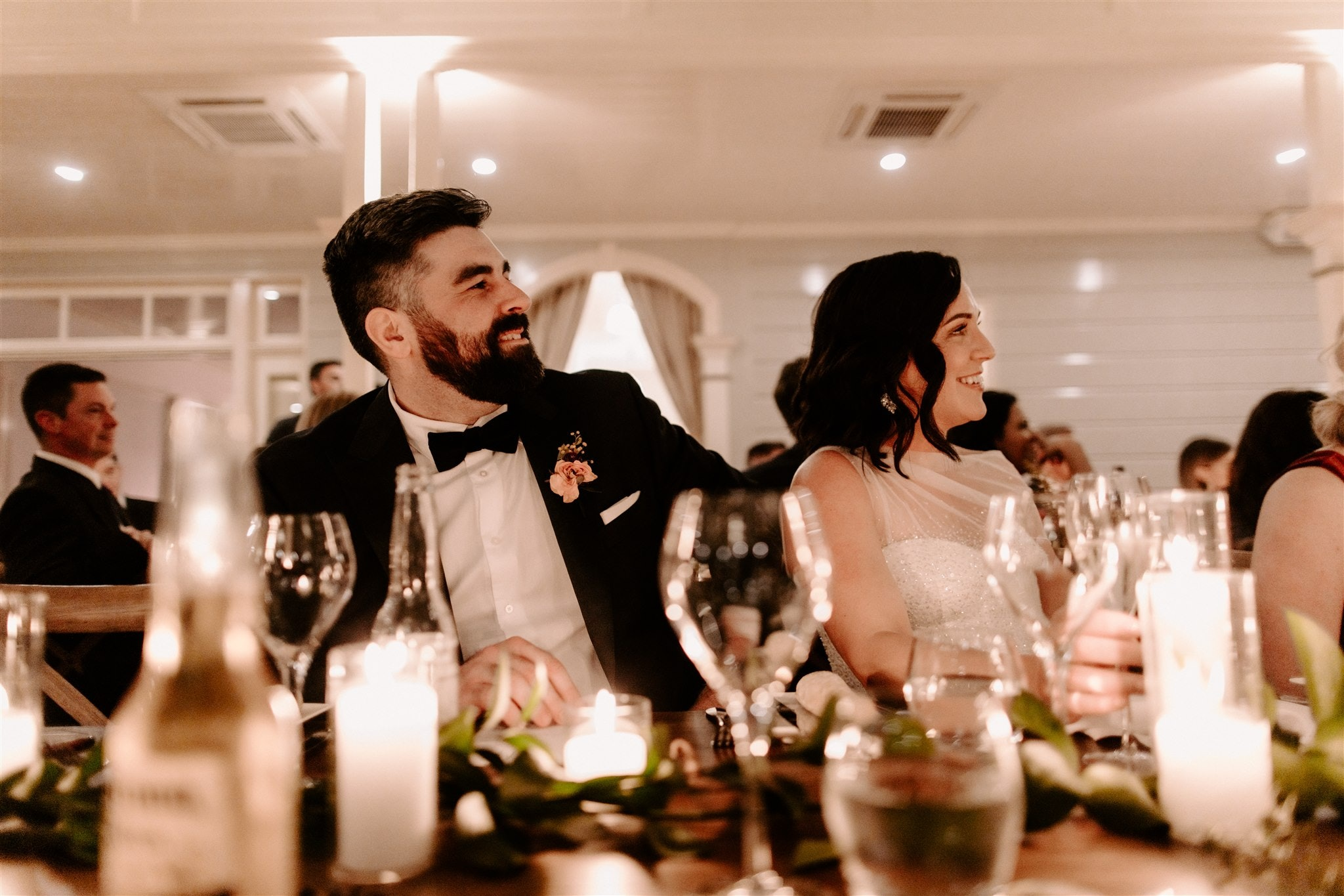 Bride and Groom sitting next to one another at reception