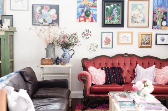 Eclectic wall art, couch and lounge room styling