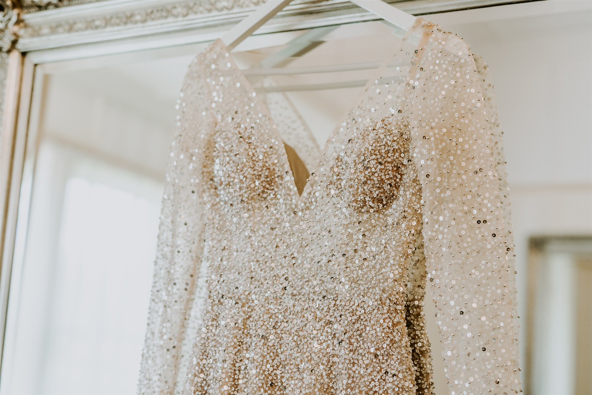 Beaded dress hanging off a mirror