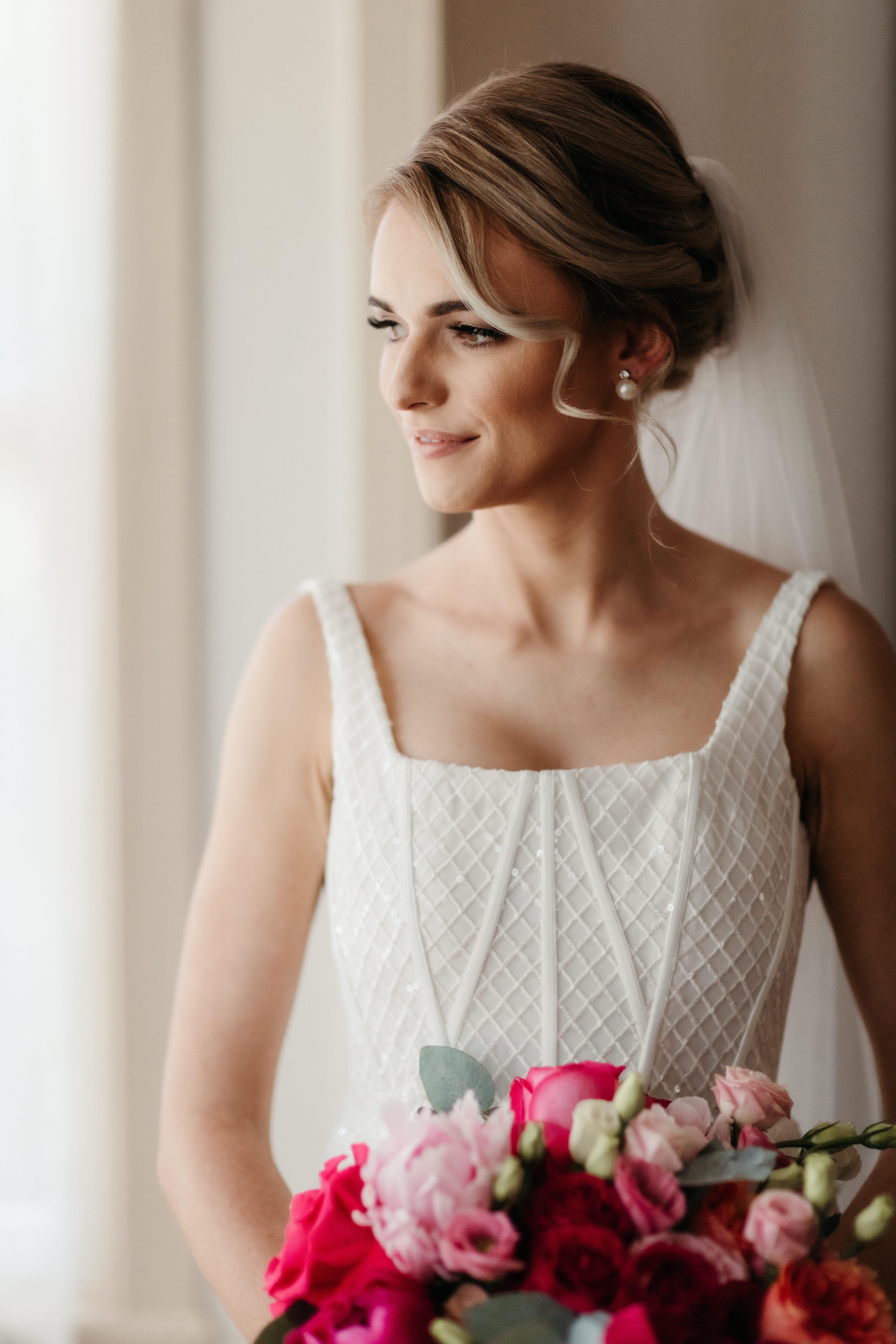 Bride holding bouquet posing