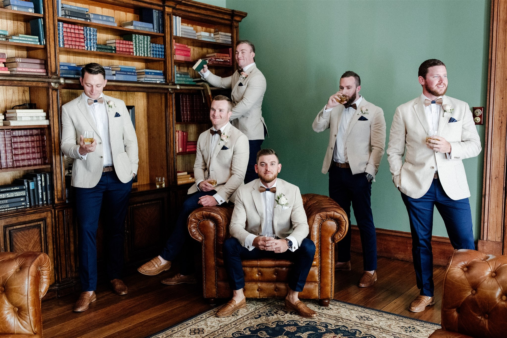 Groom and groomsmen spending time together in library