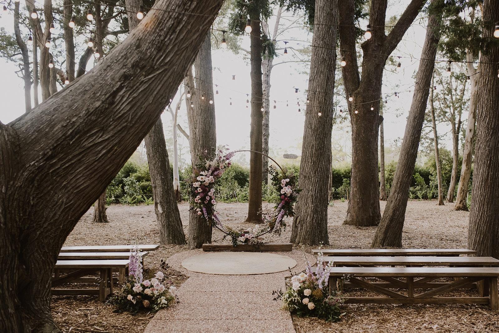 Floral circular arbor in woodland setting
