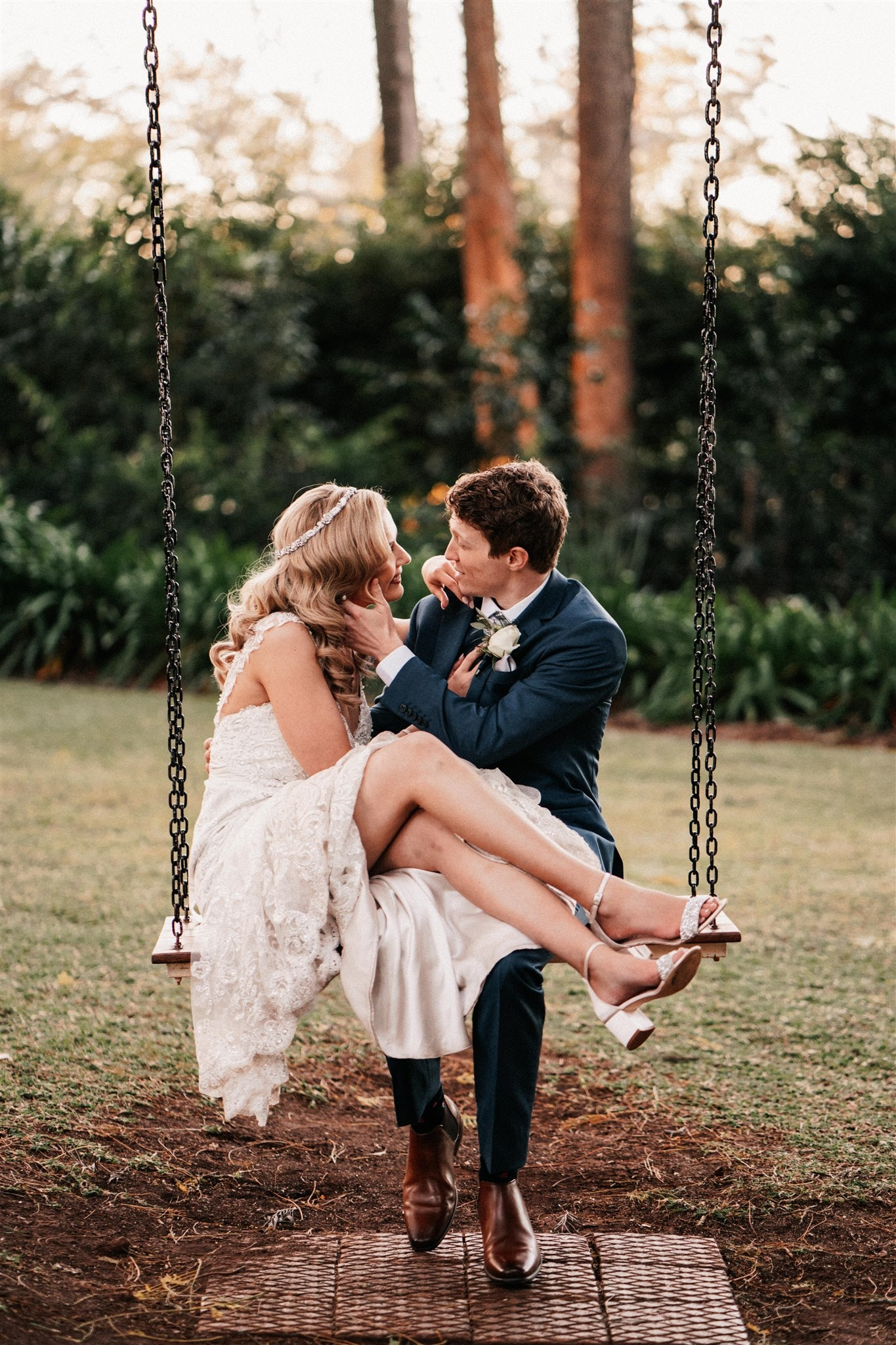 Bride and groom sitting on swing