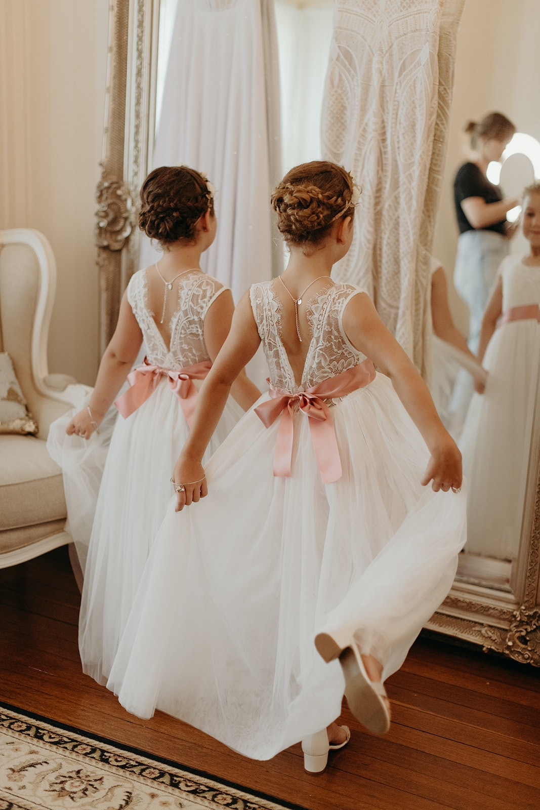 Bridesmaids standing in front of mirror