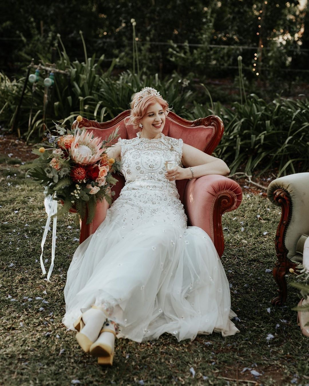 Bride sitting in pink accent chair