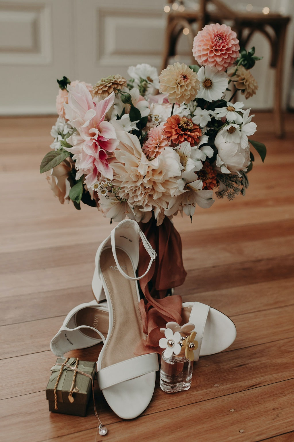 bouquet shot with shoes and perfume