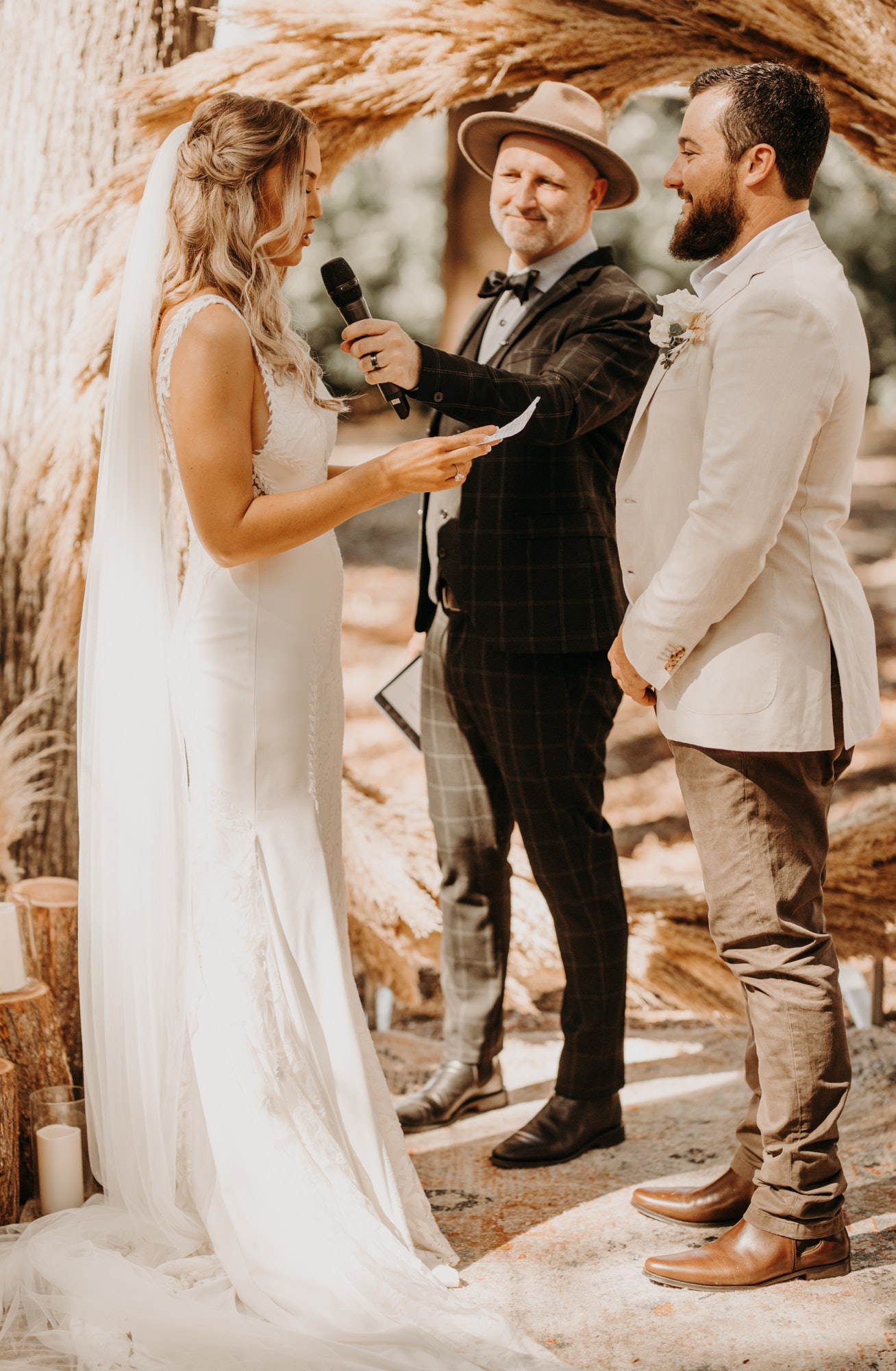 Bride and groom reading vows to one another