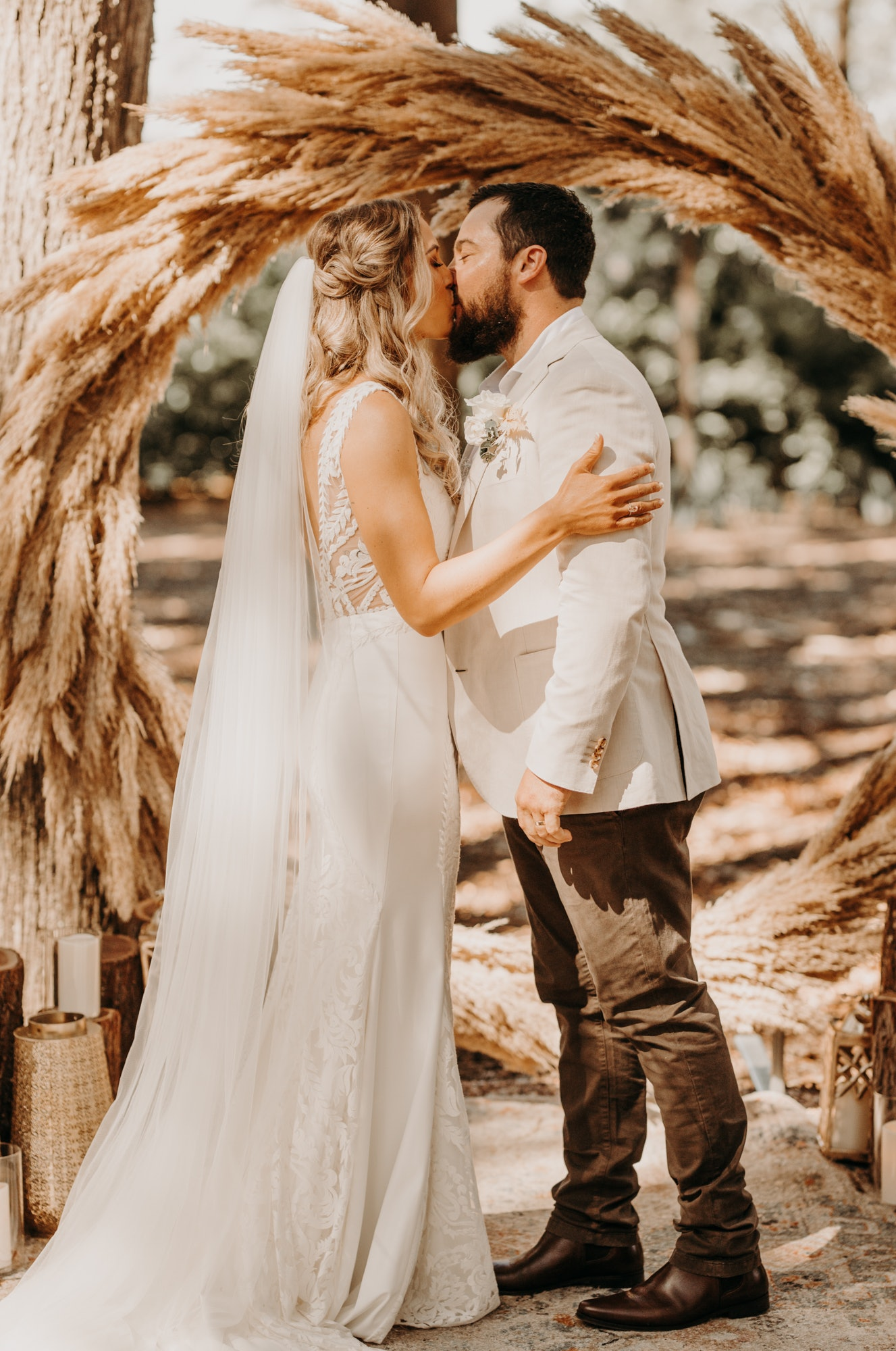 Bride and groom standing at altar kissing